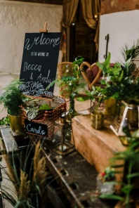 cow-shed-crail-wedding-welcome-table-tropical-style