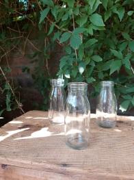 Mini milk bottle vases (65 available) - Hire Cost 50p each